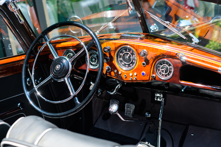 Steering wheel, dashboard and interior of a beautiful vintage car cockpit at Classic Days, a classic car event for vintage cars and vehicles in Berlin Editorial