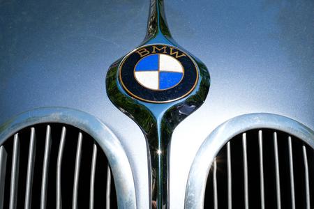 Car design detail on BMW logo / brand name closeup on vintage automobile