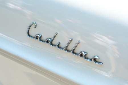 Car design detail and CADILLAC logo  brand name lettering closeup on vintage automobile