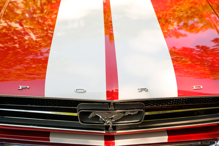 Front grill and bonnet of a Ford Mustang car showing the logo design  brand name at Oldtimer Automobile Event in Berlin, Germany Editorial