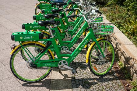 Berlin, Germany - july 2018: E-bikes, many  electric bicycles of public bike sharing company LimeBike in Berlin, Germany