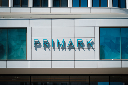 Primark logo on shop facade in Berlin, Germany. Primark is a low cost, Ireland-based clothes and fashion retailer.