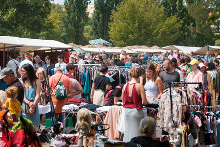 People on crowded flea market on a sunny summer sunday in Berlin, Germany