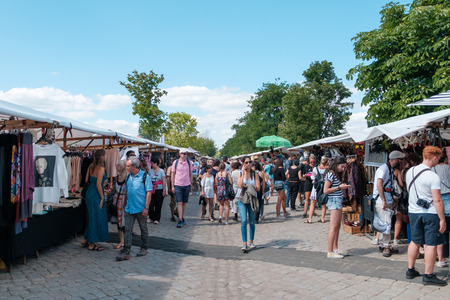 Berlin, Germany - july 2018: People on crowded flea market ( Mauerpark Flohmarkt) on a sunny summer sunday in Berlin , Germany