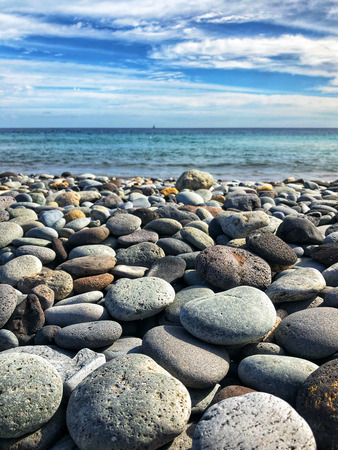 pebble stone beach with ocean background