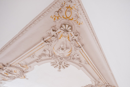 renewed stucco decoration detail on ceiling in historic flat  -