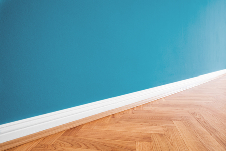 primed  wall blue painted and wooden parquet floor - renovation background