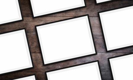 set of frames on wood background - blank picture frames mock-up