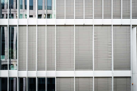 building facade with closed shutters, sun blinds, modern office