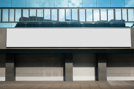blank billboard on closed retail store - shop name mock-up / empty banner Standard-Bild