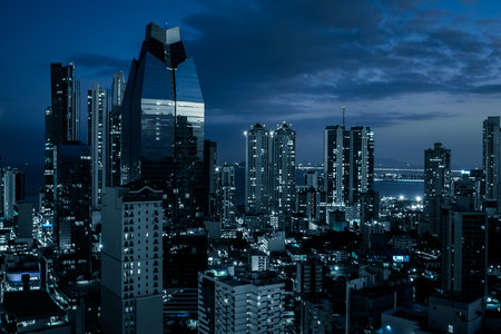 city skyline at night - modern office buildings in business district -