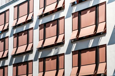 sun blinds on building facade , modern sunshades / awnings Foto de archivo