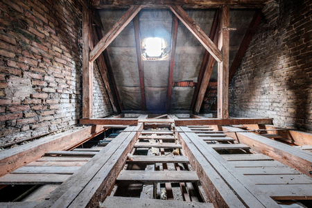 floor beams in empty attic / loft of an old building roof Reklamní fotografie