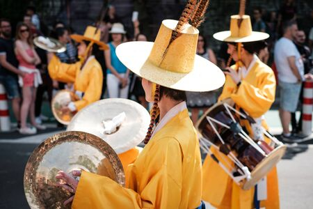 Korean people in traditional costumes performing at Carnival of Cultures in Berlin Stock Photo