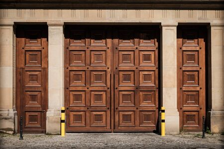 massive wooden gate entrance on building - huge wood door