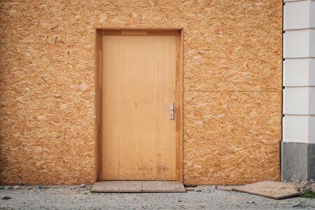 Temporary entrance door , wooden door made of chipboard