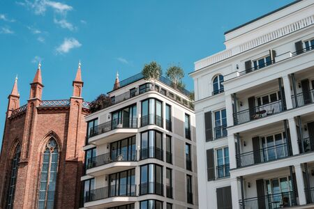 modern architecture apartment buildings and old church - real estate in Berlin, Mitte