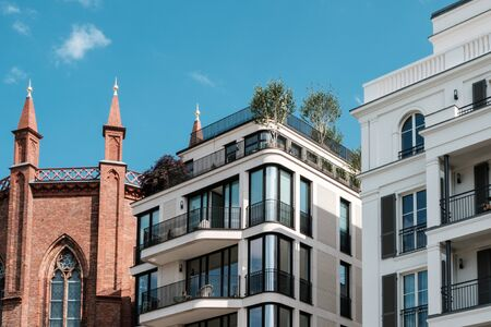 modern apartment buildings and old church facade -  real estate Berlin, Mitte -