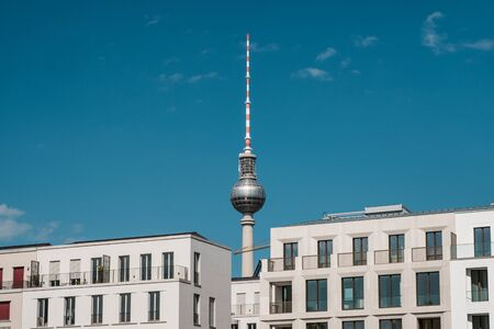 real estate in Berlin concept - apartment buildings and tv tower -