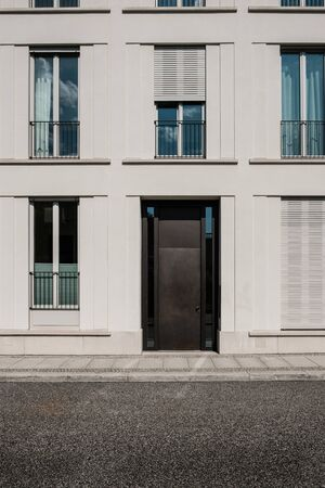 entrance door on modern building  with empty street