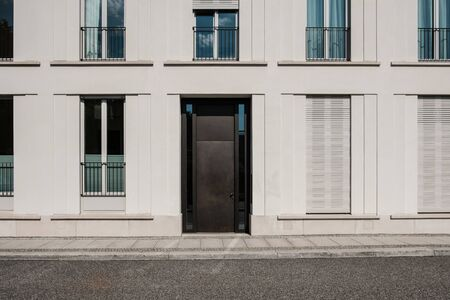entrance door on modern building  with empty street - house door