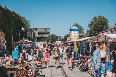 People on a raw flea market on a sunny sunday in Berlin, Friedrichshain