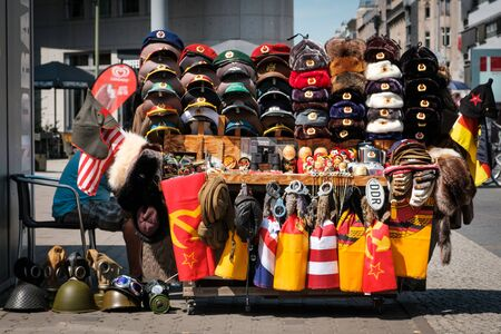 Souvenir vendor selling Cold War objects from East Germany (GDR) on street in Berlin