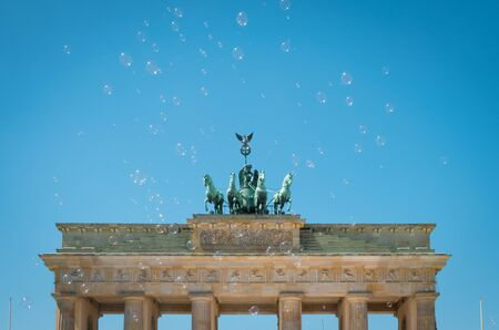Brandenburg Gate / Brandenburger Tor on sunny day with blue sky and soap bubbles -