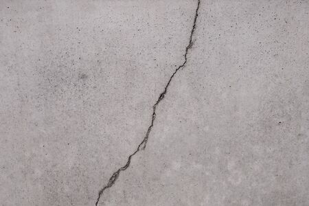 Cracked concrete, crack on stone texture Banco de Imagens