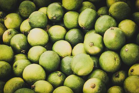 lime fruit  - pile of green lime fruits Фото со стока