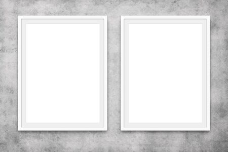 two blank picture frames hanging on concrete wall, mock-up Stock fotó