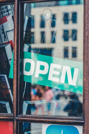 open sign in store entrance - open sign in shop window
