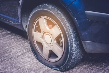 Closeup of a flat tire on car - tire change concept