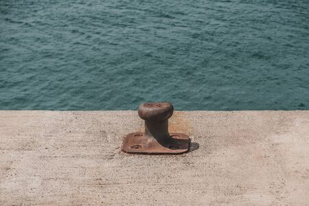 Empty coastal mooring or towing bollard for the boat, yacht or vessel.