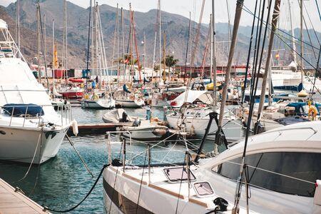 Sailboats, motor boats and yachts at Harbor in Tenerife