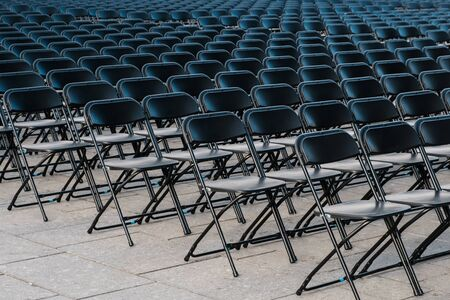 rows of folding chairs, empty seats on event - chair row
