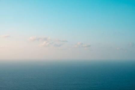 blue sky and ocean horizon on sunny summer day  -