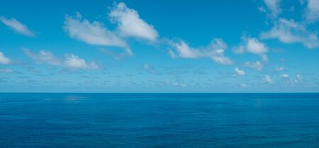 blue sky with clouds over water - ocean horizon , sea background