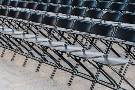 rows of folding chairs, empty seats - chair row Reklamní fotografie