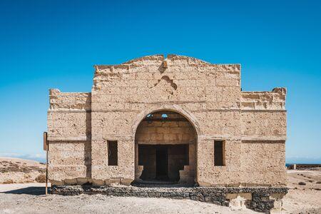 abandoned house ruin in desert landscape - building shell