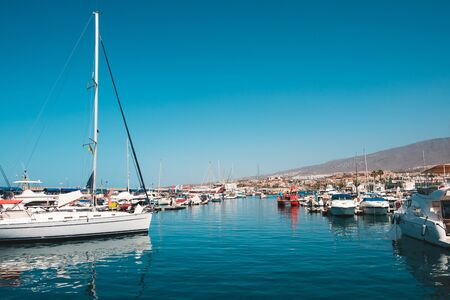 Tenerife, Spain - August, 2019: Many motor  boats, sailboats and yachts harbour in Tenerife Stok Fotoğraf