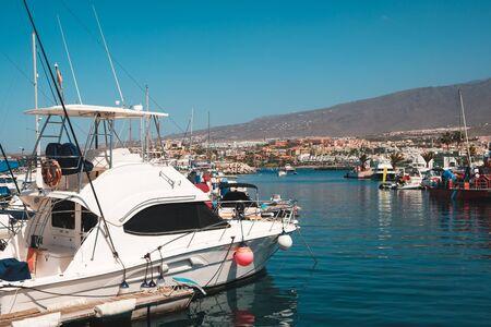 Many motor boats, sailboats and yachts harbor