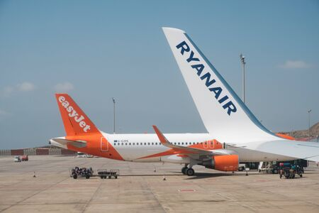 Ryanair and Easyjet Airplanes. Both Airline Companies competing for low cost flights. Editorial