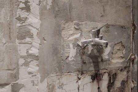 old water tap during bathroom renovation, plumber backgound - 写真素材