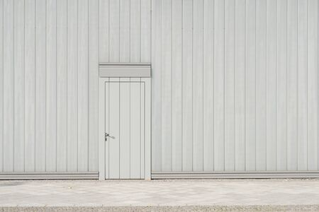 wall and door on street - building facade and entrance door with copy space