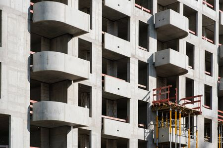 building shell of apartment building under construction - real estate -