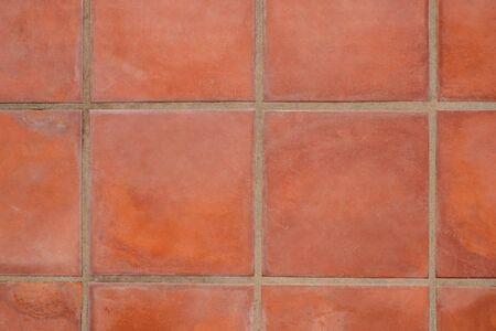 terracotta tiled floor background - terracotta tiles closeup