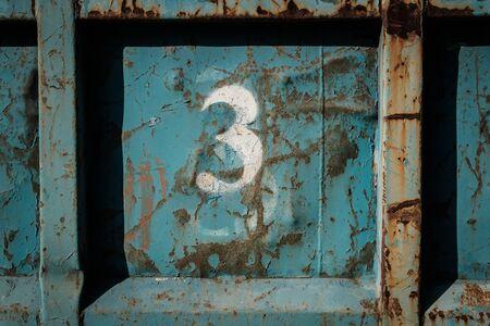 number 3 (three) painted on vintage metal background Stock fotó