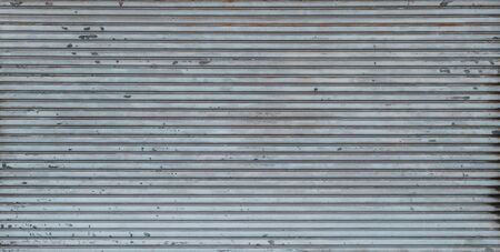 metal shutter background texture on store or shop front