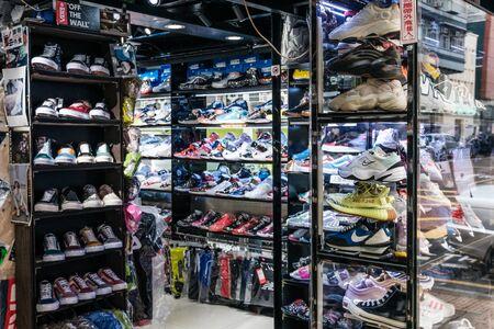 Hongkong - November, 2019: Collection of sneakers in urban sports wear retail shop at sneaker street in HongKong